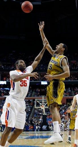 Missouri's Keith Ramsey, right, shoots over Clemson's Trevor Booker (35) during the first half of an NCAA first-round college basketball game in Buffalo, N.Y., on Friday, March 19, 2010.  (AP Photo/David Duprey) By David Duprey