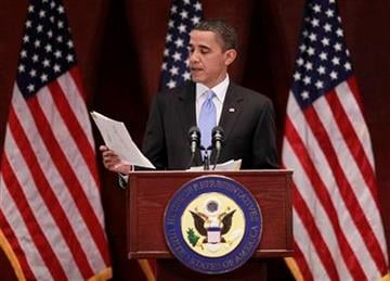 President Barack Obama reads letters that he has received during his visit to Capitol Hill to meet with House Democrats in Washington, Saturday, March 20, 2010. (AP Photo/Pablo Martinez Monsivais) By Pablo Martinez Monsivais