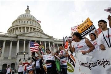 Demonstrators march in front of the Capitol Hill during a rally for immigration reform at the National Mall in Washington, on Sunday, March 21, 2010..(AP Photo/Jose Luis Magana) By Jose Luis Magana