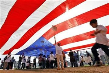Rafael Geronimo, a farm worker of Immokalee, Fla., holds up a giant American flag while attending a rally for immigration reform on the National Mall in Washington, on Sunday, March 21, 2010. (AP Photo/Jose Luis Magana) By Jose Luis Magana