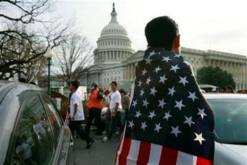 Osman Villanueva, 23, of Baltimore, Md., watches as immigration reform supporters march by the Capitol during a rally in Washington, on Sunday, March 21, 2010. (AP Photo/Jacquelyn Martin) By Jacquelyn Martin