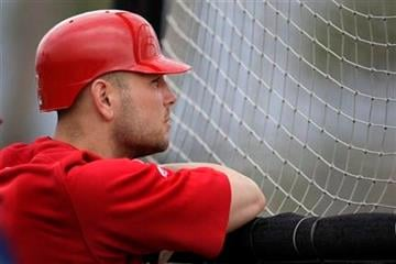 St. Louis Cardinals'  Matt Holliday stands behind a batting cage during spring training baseball Wednesday, Feb. 24, 2010, in Jupiter, Fla. (AP Photo/Jeff Roberson) By Jeff Roberson