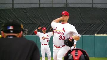 Cardinals starting pitcher Brad Penny throws a pitch during warm-ups before Monday's game between the Cardinals and Red Sox By Lakisha Jackson