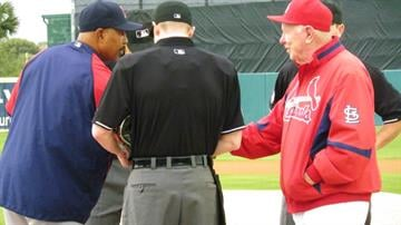 Cardinals Hall-of-Famer Red Schoendienst shakes hands with a Boston Red Sox coach at home plate before Monday's game between the Cardinals and Red Sox By Lakisha Jackson