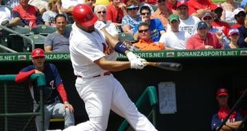 Albert Pujols swings at a pitch in the first inning of Tuesday's Nationals-Cardinals game By Lakisha Jackson