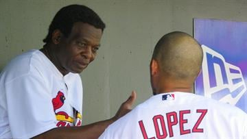 Cardinals legend Lou Brock talks with Felipe Lopez in the dugout during Wednesday's game between the Orioles and the Cardinals By Lakisha Jackson