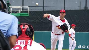 Cardinals pitcher Chris Carpenter throws a pitch during warm-ups of Thursday's game featuring the Cardinals and the New York Mets. By Lakisha Jackson