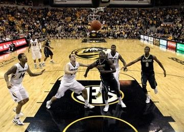 COLUMBIA, MO - JANUARY 26:  Players watch as a shot goes in during the game between the Vanderbilt Commodores and the Missouri Tigers at Mizzou Arena on January 26, 2013 in Columbia, Missouri.  (Photo by Jamie Squire/Getty Images) By Jamie Squire