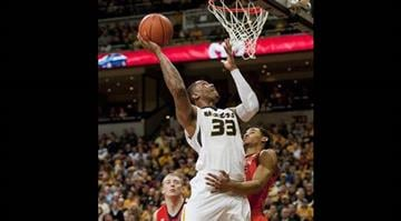 Missouri's Earnest Ross, top, shoots over Auburn's Shaquille Johnson, right, and past Rob Chubb, left, during the first half of an NCAA college basketball game Saturday, Feb. 2, 2013, in Columbia, Mo. (AP Photo/L.G. Patterson) By L.G. Patterson