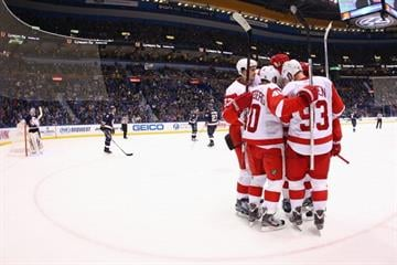 ST. LOUIS, MO - FEBRUARY 7: Members of the Detroit Red Wings celebrate a goal against the St. Louis Blues at the Scottrade Center on February 7, 2013 in St. Louis, Missouri. (Photo by Dilip Vishwanat/Getty Images) By Dilip Vishwanat