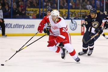 ST. LOUIS, MO - FEBRUARY 7: Drew Miller #20 of the Detroit Red Wings move the puck up the ice against the St. Louis Blues at the Scottrade Center on February 7, 2013 in St. Louis, Missouri. (Photo by Dilip Vishwanat/Getty Images) By Dilip Vishwanat