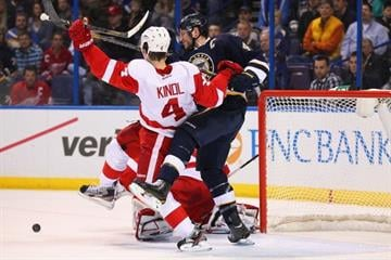 ST. LOUIS, MO - FEBRUARY 7: David Backes #42 of the St. Louis Blues holds Jakub Kindl #4 of the Detroit Red Wings off the puck at the Scottrade Center on February 7, 2013 in St. Louis, Missouri.  (Photo by Dilip Vishwanat/Getty Images) By Dilip Vishwanat