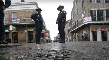 Louisiana State Police stand near the 400 block of Bourbon Street in the French Quarter in New Orleans, Sunday, Feb. 10, 2013. AP Photo By Dan Mueller