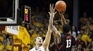 Illinois' Tracy Abrams (13) shoots a 3-pointer over Minnesota's Elliott Eliason (55) towards the end of the second half of an NCAA college basketball game, Sunday, Feb. 10, 2013, in Minneapolis. Illinois won 57-53. (AP Photo/Genevieve Ross) By Dan Mueller