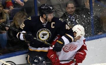 St. Louis Blues David Backes gives Detroit Red Wings Ian White an elbow in the first period at the Scottrade Center in St. Louis on February 7, 2013. UPI/Bill Greenblatt By BILL GREENBLATT