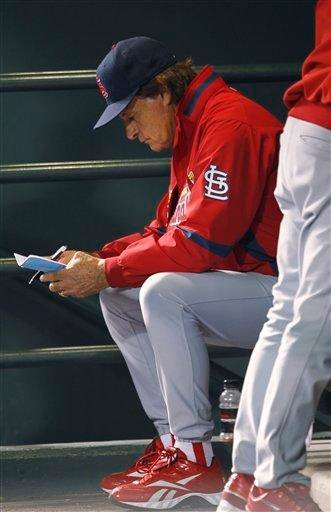 St. Louis Cardinals manager Tony LaRussa looks over his lineup card in the  ninth inning of the Colorado Rockies' 8-7 victory over the Cardinals in a baseball game in Denver on Wednesday, July 7, 2010. (AP Photo/David Zalubowski) By David Zalubowski