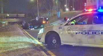 Accident reconstruction officials examine the scene of an overturned vehicle in south St. Louis. By KMOV Web Producer