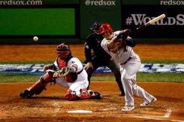 BOSTON, MA - OCTOBER 24: Yadier Molina #4 of the St. Louis Cardinals hits against the Boston Red Sox during Game Two of the 2013 World Series at Fenway Park on October 24, 2013 in Boston, Massachusetts.  (Photo by Jim Rogash/Getty Images) By Jim Rogash