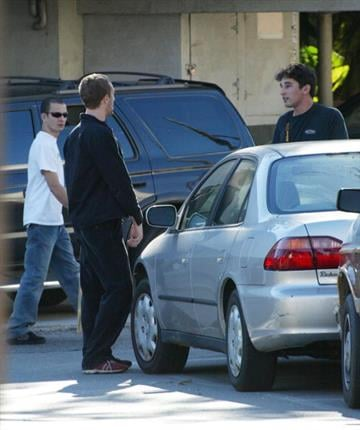 BRENTWOOD, CA - JANUARY 2:  Actress Gwyneth Paltrow's boyfriend, Coldplay singer Chris Martin (L) confronts a photographer on January 2, 2003 in Brentwood, California.  (Photo by Mel Bouzad/Getty Images) By Mel Bouzad