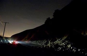 A car sits rolled over near a rockslide, right, in the wake of Friday nights March 28, 2014 earthquake on Carbon Canyon Road in Brea, Calif., near Olinda Village. (AP Photo/The Orange County Register, Rod Veal) By ROD VEAL,