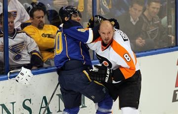 St. Louis Blues Alexender Steen roughs up Philadelphia Flyers Nicklas Grossmann in the first period at the Scottrade Center in St. Louis on April 1, 2014.   UPI/Bill Greenblatt By BILL GREENBLATT