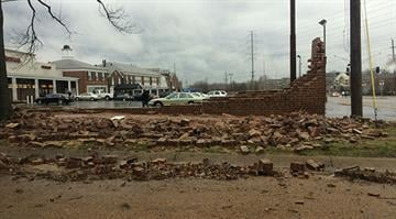 A massive storm damaged a wall near the Walgreens on the corner of Delmar and McKnight in U City. By Brendan Marks