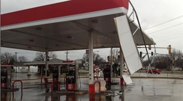 Thursday morning's storms blew part of the roof off of the Phillips 66 gas station in Madison, Ill. By Brendan Marks