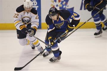 Buffalo Sabres Johan Larsson uses his stick to slow St. Louis Blues T.J. Oshie in the first period at the Scottrade Center in St. Louis on April 3, 2014. UPI/Bill Greenblatt By BILL GREENBLATT
