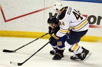 St. Louis Blues Kevin Shattenkirk is pulled down by Buffalo Sabres Nicolas Deslauriers in the first period at the Scottrade Center in St. Louis on April 3, 2014. UPI/Bill Greenblatt By BILL GREENBLATT