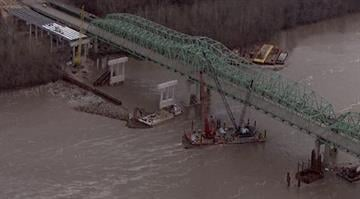 The eastbound lanes of the interstate were closed at Route K as crews worked to remove the crane, which broke free on the Missouri River and came to rest on the eastbound truss of the Daniel Boone Missouri River Bridge. By Brendan Marks