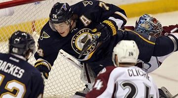 St. Louis Blues T.J. Oshie crashes into Colorado Avalanche goaltender Semyon Variamov of Russia in the first period at the Scottrade Center in St. Louis on April 5, 2014.   UPI/Bill Greenblatt By BILL GREENBLATT