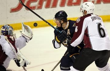 St. Louis Blues T. J. Oshie (74) follows the puck into the glove of Colorado Avalanche goaltender Semyon Varlamov of Russia in the first period at the Scottrade Center in St. Louis on April 5, 2014.   UPI/Bill Greenblatt By BILL GREENBLATT