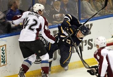 Colorado Avalanche Brad Malone wacks St. Louis Blues Vladimir Sobotka of the Czech Republic with his stick in the first period at the Scottrade Center in St. Louis on April 5, 2014.   UPI/Bill Greenblatt By BILL GREENBLATT
