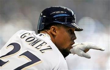 Milwaukee Brewers' Carlos Gomez reacts after his RBI-triple during the first inning of an opening day baseball game between the Brewers and the St. Louis Cardinals, Friday, April 6, 2012, in Milwaukee. (AP Photo/Jeffrey Phelps) By Jeffrey Phelps