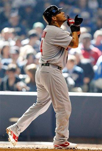 St. Louis Cardinals' Yadier Molina reacts after hitting a home run in the second inning of an opening day baseball game against the Milwaukee Brewers, Friday, April 6, 2012, in Milwaukee. (AP Photo/Jeffrey Phelps) By JEFFREY PHELPS