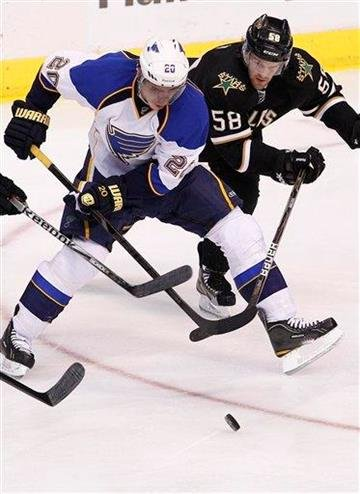 St. Louis Blues left wing Alexander Steen (20) and Dallas Stars Jordie Benn (58) battle for control of the puck during the first period of an NHL Hockey game, Saturday, April 7, 2012, in Dallas. (AP Photo/Brandon Wade) By Brandon Wade