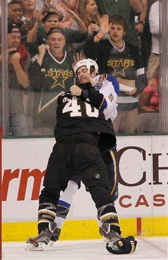 St. Louis Blues defenseman Barret Jackman (5) and Dallas Stars center Ryan Garbutt (40) fight during the second period of an NHL Hockey game, Saturday, April 7, 2012, in Dallas. (AP Photo/Brandon Wade) By Brandon Wade