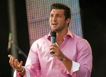 New York Jets quarterback Tim Tebow speaks at the Easter service of Celebration Church in Georgetown, Texas, Sunday, April 8, 2012. (AP Photo/William Philpott) By William Philpott