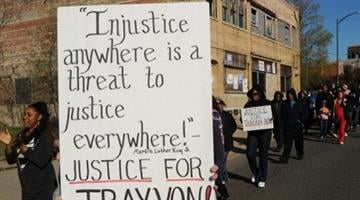 "Dozens of supporters walk down Pipestone Street in Benton Harbor, Mich., Friday, April 6, 2012, during a ""hoodie march"" and rally for Trayvon Martin. (AP Photo/The Herald-Palladium, Don Campbell) By KMOV Web Producer"