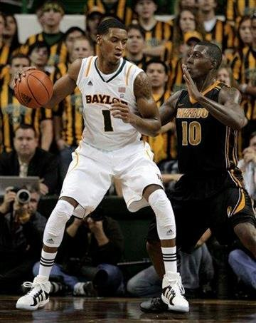 Baylor forward Perry Jones III (1) looks for an opening against Missouri forward Ricardo Ratliffe (10) in the first half of an NCAA college basketball game Saturday, Jan. 21, 2012, in Waco, Texas. (AP Photo/Tony Gutierrez) By Tony Gutierrez