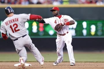 Brandon Phillips #4 of the Cincinnati Reds turns a double play in the third inning against the St. Louis Cardinals at Great American Ball Park on April 9, 2012 in Cincinnati, Ohio. (Photo by Joe Robbins/Getty Images) By Joe Robbins