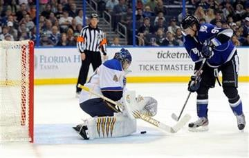 St. Louis Blues goalie Jaroslav Halak, left, of Slovakia, defends the goal from Tampa Bay Lightning center Steven Stamkos during the second period of an NHL hockey game, Saturday, March 17, 2012, in Tampa, Fla. (AP Photo/Brian Blanco) By Brian Blanco