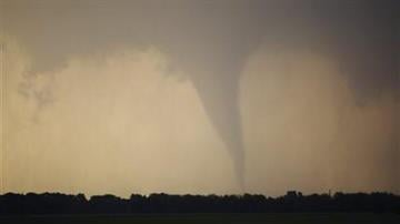 A tornado forms and touches down north of Soloman, Kan., Saturday, April 14, 2012. (AP Photo/Orlin Wagner) By KMOV Web Producer