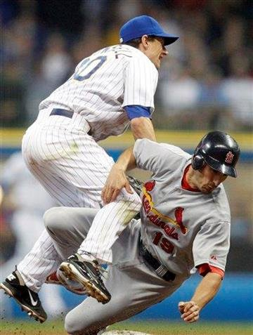 Milwaukee Brewers' Craig Counsell, left, forces out St. Louis Cardinals' Matt Carpenter(19) at second base during a baseball game on  Friday, June 10, 2011, in Milwaukee. (AP Photo/Jeffrey Phelps) By Jeffrey Phelps