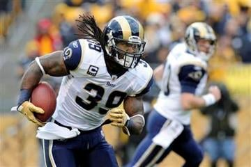 St. Louis Rams running back Steven Jackson (39) runs a handoff from Kellen Clemens, rear right, in the first quarter of an NFL football game against the Pittsburgh Steelers on Saturday, Dec. 24, 2011, in Pittsburgh. (AP Photo/Don Wright) By Don Wright