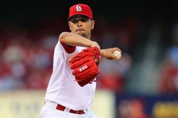 ST. LOUIS, MO - APRIL 18: Starter Jaime Garcia #54 of the St. Louis Cardinals pitches against the Cincinnati Reds at Busch Stadium on April 18, 2012 in St. Louis, Missouri.  (Photo by Dilip Vishwanat/Getty Images) By Dilip Vishwanat