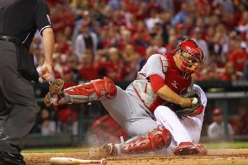 ST. LOUIS, MO - APRIL 18: Devin Mesoraco #39 of the Cincinnati Reds tags out Jaime Garcia #54 of the St. Louis Cardinals at Busch Stadium on April 18, 2012 in St. Louis, Missouri.  (Photo by Dilip Vishwanat/Getty Images) By Dilip Vishwanat