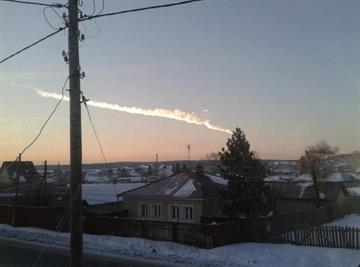 A meteorite contrail is seen over a village of Bolshoe Sidelnikovo on Feb. 15, 2013. Credit: AP Photo/ Nadezhda Luchinina, E1.ru By Dan Mueller