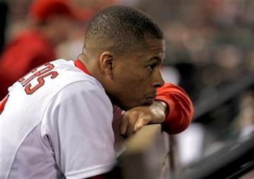 St. Louis Cardinals' Adron Chambers is seen in the dugout during the eighth inning of a baseball game against the Chicago Cubs, Friday, Sept. 23, 2011, in St. Louis. (AP Photo/Jeff Roberson) By Jeff Roberson