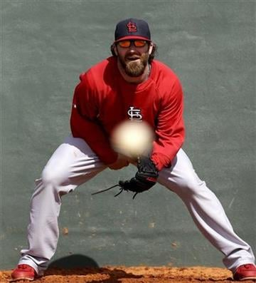 St. Louis Cardinals relief pitcher Jason Motte fields grounders at spring training baseball, Tuesday, Feb. 19, 2013, in Jupiter, Fla. (AP Photo/Julio Cortez) By Julio Cortez